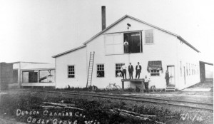 Dutch Canning Factory in Cedar Grove, Wisconsin.  Henry Walvoord is standing in the doorway to the right.