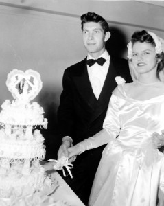 Mr. & Mrs. Bill Forbes cut the wedding cake